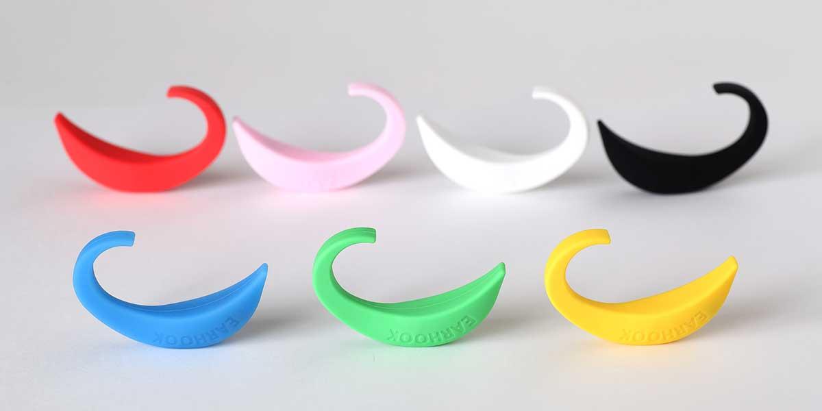 赤、ピンク、白。黒、青、緑、黄色の7色展開|ネオジム磁石で耳裏のツボを刺激。EARHOOK(イヤーフック)