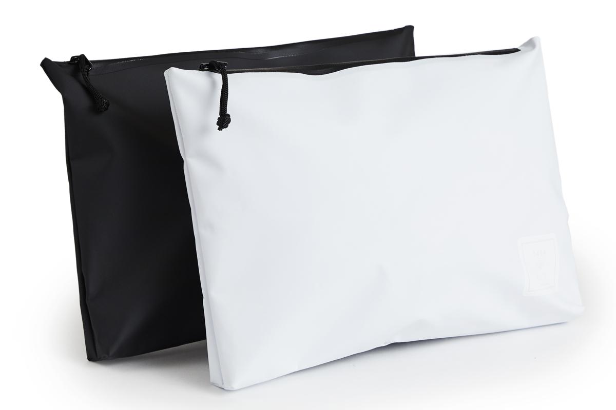 スタイリッシュな都会的デザインの防水性クラッチバッグ